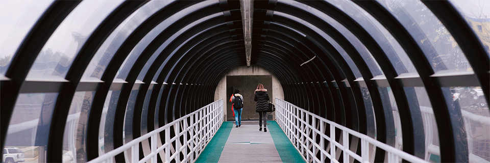 This is a picture of students walking down the tunnels in winter time.